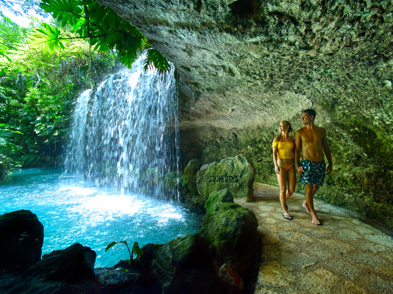 Culture and Wildlife in the Mayan Riviera couple and a waterfall