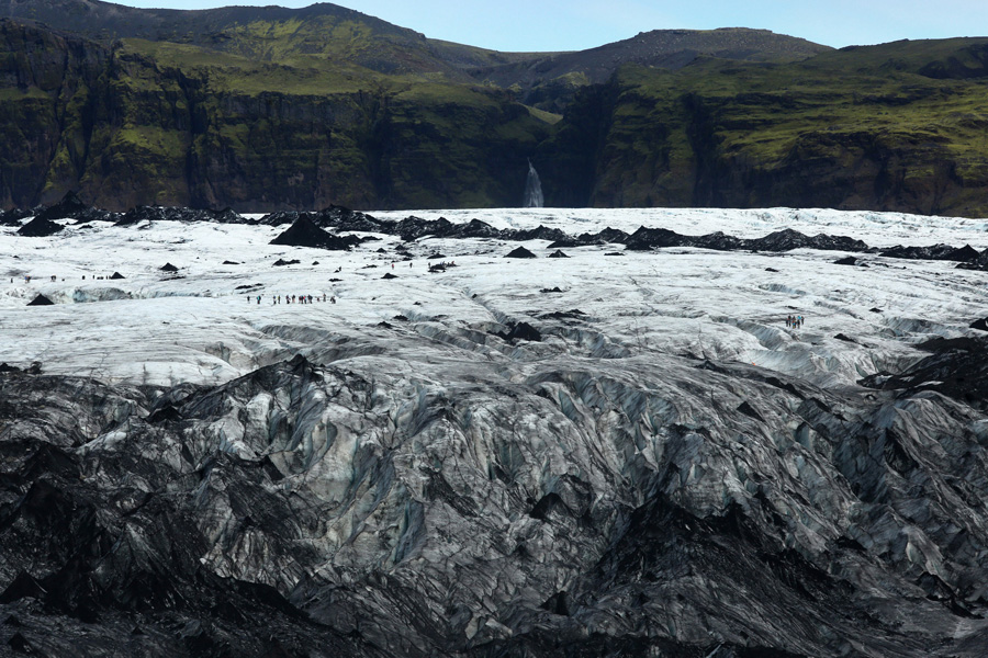Nat Geo Expeditions - Iceland South Coast Adventure - Glacier and waterfall in Iceland