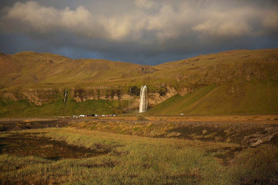 Nat Geo Expeditions - Iceland South Coast Adventure - Waterfall and green mountains
