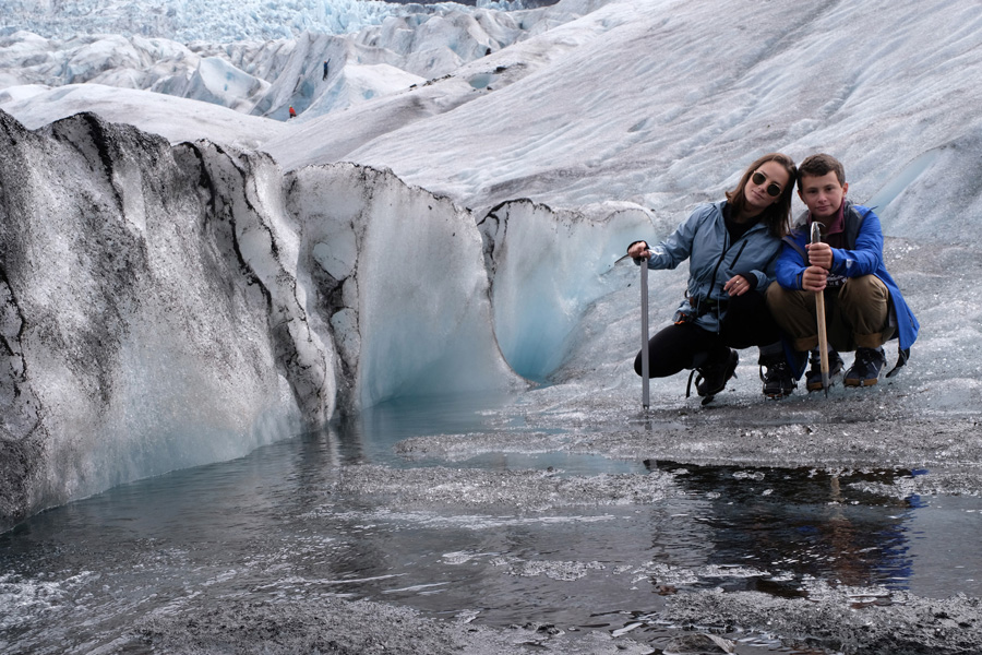 Nat Geo Expeditions - Iceland South Coast Adventure - Two people in the ice