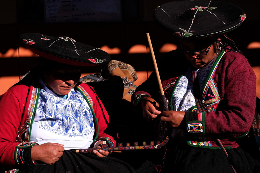 Splendors of the Inca Corporate Expedition - Women playing instruments