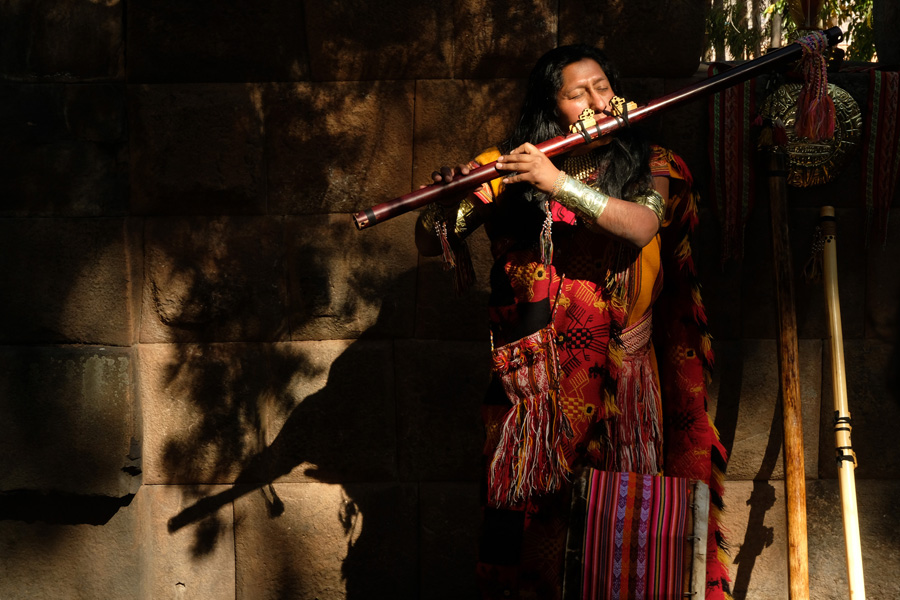 Splendors of the Yucatan - Man in traditional clothes playing a big flute